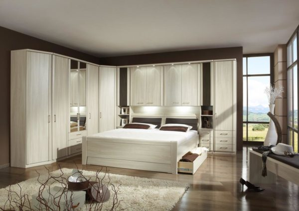 Luxor Bedroom by Weimann with built-in storage in nice wood finish with LED accents.